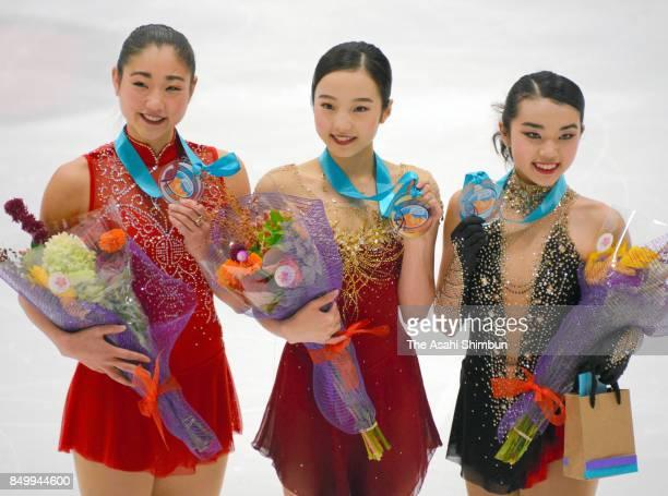Silver medalist Mirai Nagasu of the United States gold medalist Marin Honda of Japan and bronze medalist Karen Chen of the United States pose for...