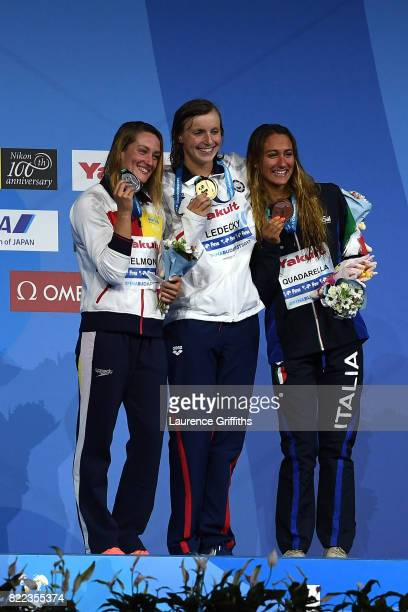 Silver medalist Mireia Belmonte of Spain gold medalist Katie Ledecky of the United States and bronze medalist Simona Quadarella of Italy pose with...