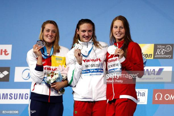 Silver medalist Mireia Belmonte of Spain gold medalist Katinka Hosszu of Hungary and bronze medalist Sydney Pickrem of Canada pose with the medals...