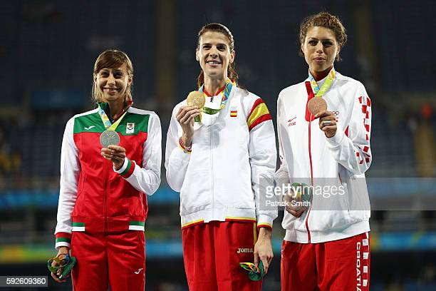 Silver medalist Mirela Demireva of Bulgaria gold medalist Ruth Beitia of Spain and bronze medalist Blanka Vlasic of Croatia stand on the podium...