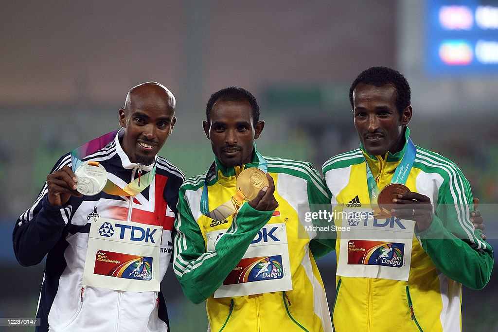 Silver medalist Mohamed Farah of Great Britain, gold medalist Ibrahim Jeilan of Ethiopia and bronze medalist Imane Merga celebrate on the podium with their medals after winning the men's 10,000 metres final during day two of the 13th IAAF World Athletics Championships at the Daegu Stadium on August 28, 2011 in Daegu, South Korea.