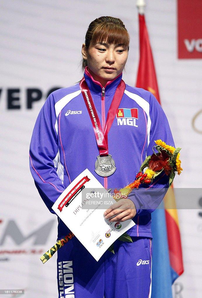 Silver medalist Mongolia's Battsetseg Soronzonbold celebrates on the podium of the women's free style 63 kg category of the World Wrestling Championships in Budapest on September 19, 2013. AFP PHOTO / FERENC ISZA