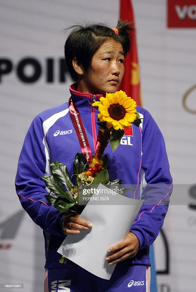 Silver medalist Mongolia's Sumiya Erdenechimeg celebrates on the podium of the women's free style 51 kg category of the World Wrestling Championships in Budapest on September 18, 2013.