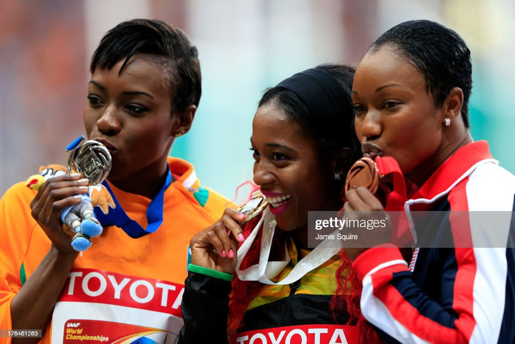 Silver medalist <a gi-track='captionPersonalityLinkClicked' href=/galleries/search?phrase=Murielle+Ahoure&family=editorial&specificpeople=7854673 ng-click='$event.stopPropagation()'>Murielle Ahoure</a> of Ivory Coast, gold medalist <a gi-track='captionPersonalityLinkClicked' href=/galleries/search?phrase=Shelly-Ann+Fraser&family=editorial&specificpeople=5493833 ng-click='$event.stopPropagation()'>Shelly-Ann Fraser</a>-Pryce of Jamaica and bronze medalist <a gi-track='captionPersonalityLinkClicked' href=/galleries/search?phrase=Carmelita+Jeter&family=editorial&specificpeople=4472760 ng-click='$event.stopPropagation()'>Carmelita Jeter</a> of the United States stand on the podium during the medal ceremony for the Women's 100 metres during Day Four of the 14th IAAF World Athletics Championships Moscow 2013 at Luzhniki Stadium on August 13, 2013 in Moscow, Russia.