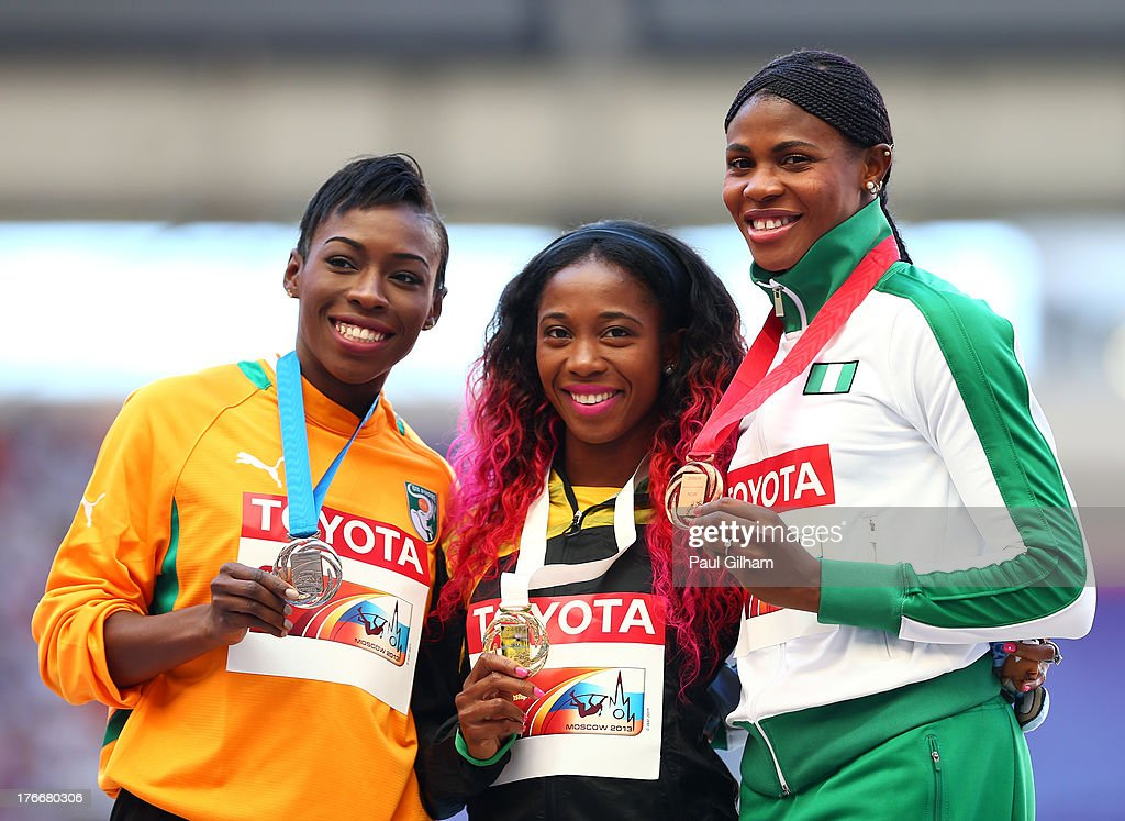 Silver medalist Murielle Ahoure of Ivory Coast, gold medalist Shelly-Ann Fraser-Pryce of Jamaica and bronze medalist Blessing Okagbare of Nigeria pose on the podium for the Women's 200 metres during Day Eight of the 14th IAAF World Athletics Championships Moscow 2013 at Luzhniki Stadium on August 17, 2013 in Moscow, Russia.