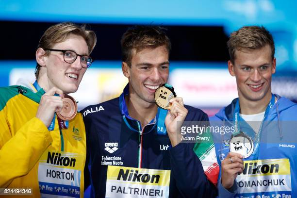 Silver medalist Mykhailo Romanchuk of Ukraine gold medalist Gregorio Paltrinieri of Italy and bronze medalist Mack Horton of Australia pose with the...