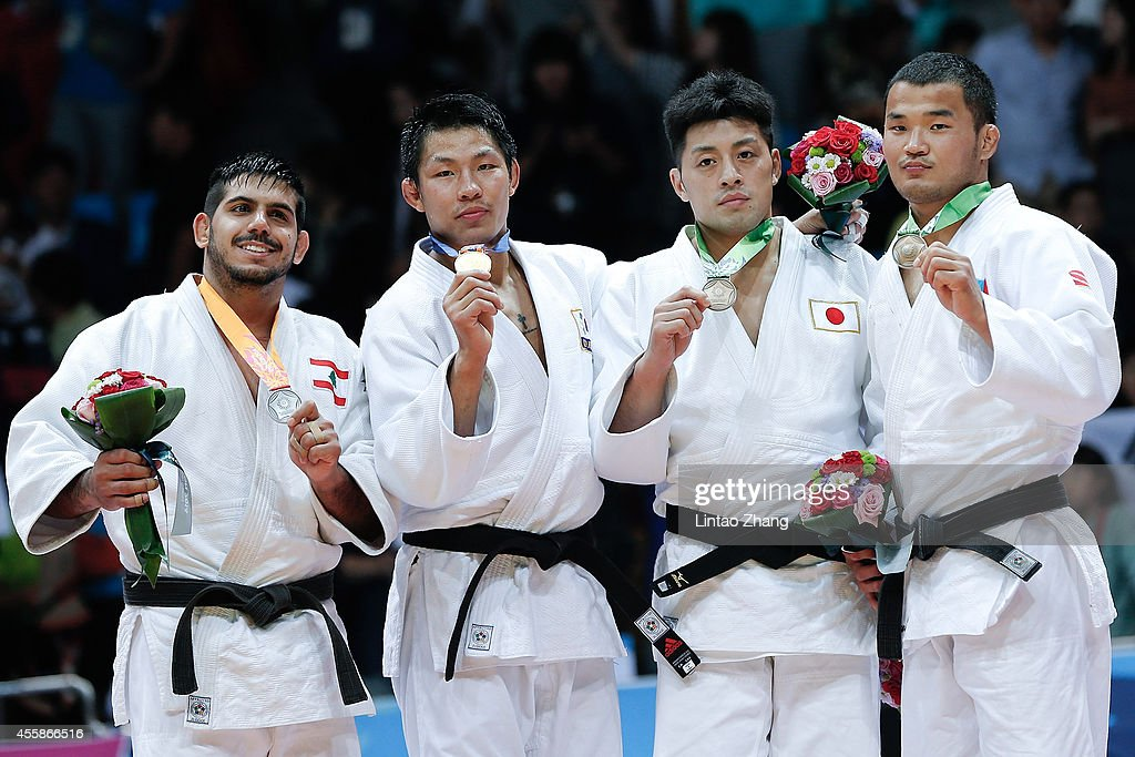 Silver medalist Nacif Elias of Lebanon, Gold medalist Jaebum Kim of South Korea, Bronze medalist Keita Nagashima of Japan and Mongolia's Tuvshinjargal Nyamsuren celebrate during the medal ceremony after the Men's -81 kg Final at Dowon Gymnasium during day two of 2014 Asian Games on September 21, 2014 in Incheon, South Korea.
