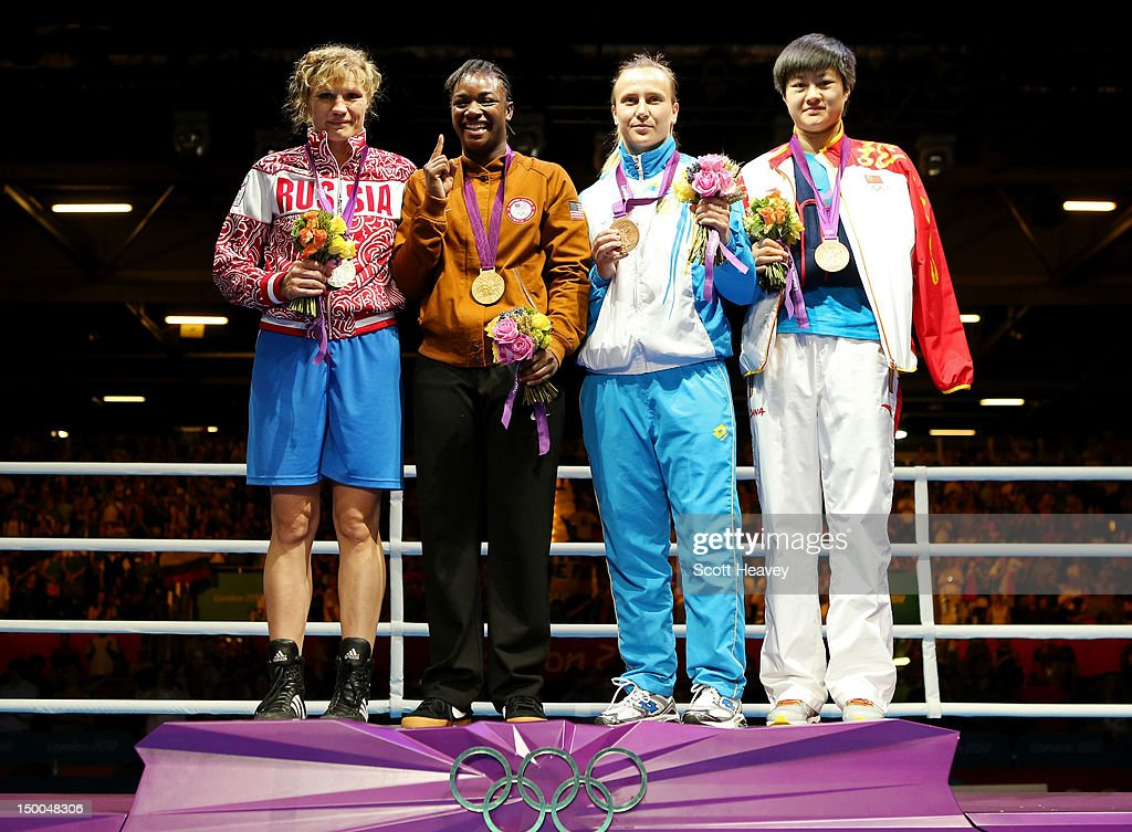 Silver medalist <a gi-track='captionPersonalityLinkClicked' href=/galleries/search?phrase=Nadezda+Torlopova&family=editorial&specificpeople=9403778 ng-click='$event.stopPropagation()'>Nadezda Torlopova</a> of Russia, gold medalist <a gi-track='captionPersonalityLinkClicked' href=/galleries/search?phrase=Claressa+Shields&family=editorial&specificpeople=8936937 ng-click='$event.stopPropagation()'>Claressa Shields</a> of the United States, bronze medalist <a gi-track='captionPersonalityLinkClicked' href=/galleries/search?phrase=Marina+Volnova&family=editorial&specificpeople=9327767 ng-click='$event.stopPropagation()'>Marina Volnova</a> of Kazakhstan and bronze medalist Jinzi Li of China celebrate on the podium during the medal ceremony for the Women's Middle (75kg) Boxing final bout on Day 13 of the London 2012 Olympic Games at ExCeL on August 9, 2012 in London, England.