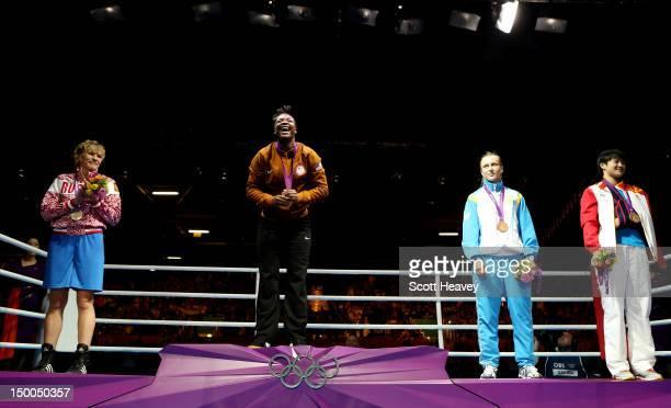 Silver medalist Nadezda Torlopova of Russia gold medalist Claressa Shields of the United States bronze medalist Marina Volnova of Kazakhstan and...