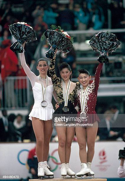 Silver Medalist Nancy Kerrigan and Gold Medalist Kristi Yamaguchi of the United States and Bronze Medalist Midori Ito of Japan celebrate after their...