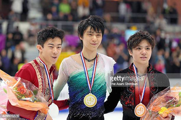 Silver medalist Nathan Chen of United States gold medalist Yuzuru Hanyu and bronze medalist Shoma Uno of Japan pose on the podium at the medal...