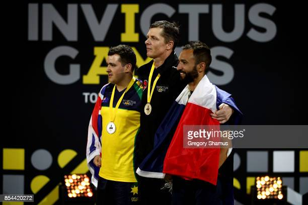 Silver medalist Nathan Parker of Australia gold medalist Craig Wilson of New Zealand and bronze medalist Jonathan Hamou of France pose on the podium...