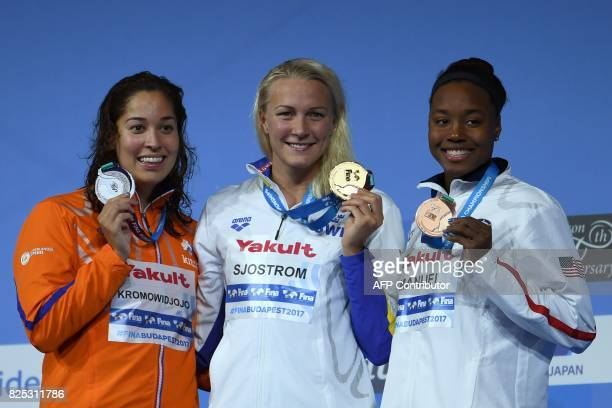 Silver medalist Netherlands' Ranomi Kromowidjojo gold medalist Sweden's Sarah Sjostrom and bronze medalist US Simone Manuel celebrate on the podium...