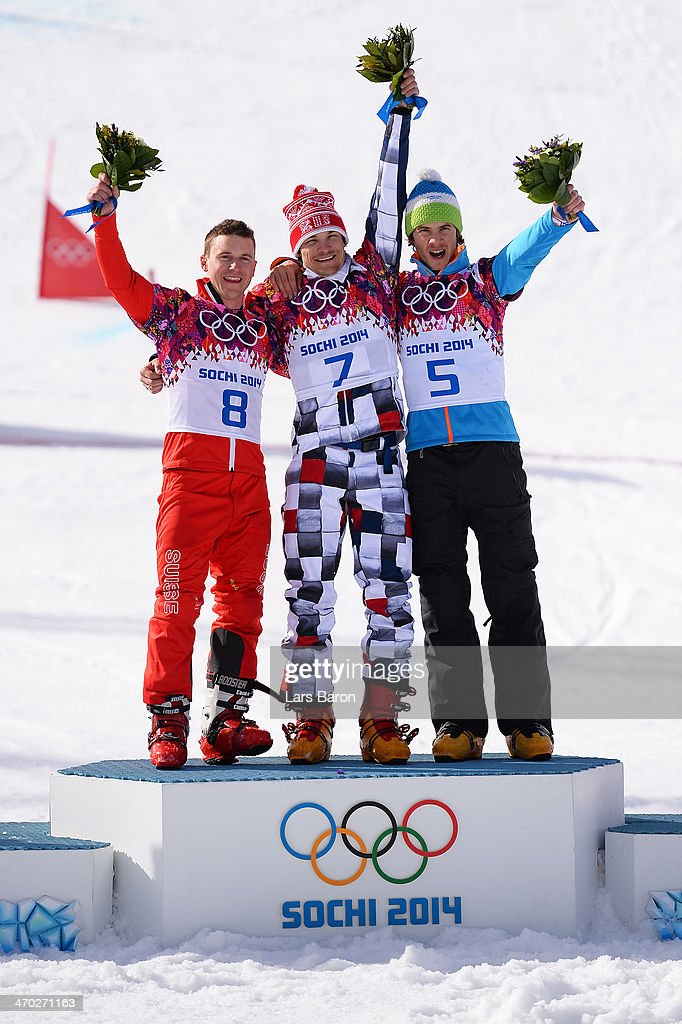 Silver medalist <a gi-track='captionPersonalityLinkClicked' href=/galleries/search?phrase=Nevin+Galmarini&family=editorial&specificpeople=10089437 ng-click='$event.stopPropagation()'>Nevin Galmarini</a> of Switzerland, gold medalist <a gi-track='captionPersonalityLinkClicked' href=/galleries/search?phrase=Vic+Wild&family=editorial&specificpeople=6691731 ng-click='$event.stopPropagation()'>Vic Wild</a> of Russia and bronze medalist Zan Kosir of Slovenia celebrate on the podium during the flower ceremony for the Snowboard Men's Parallel Giant Slalom Finals on day twelve of the 2014 Winter Olympics at Rosa Khutor Extreme Park on February 19, 2014 in Sochi, Russia.