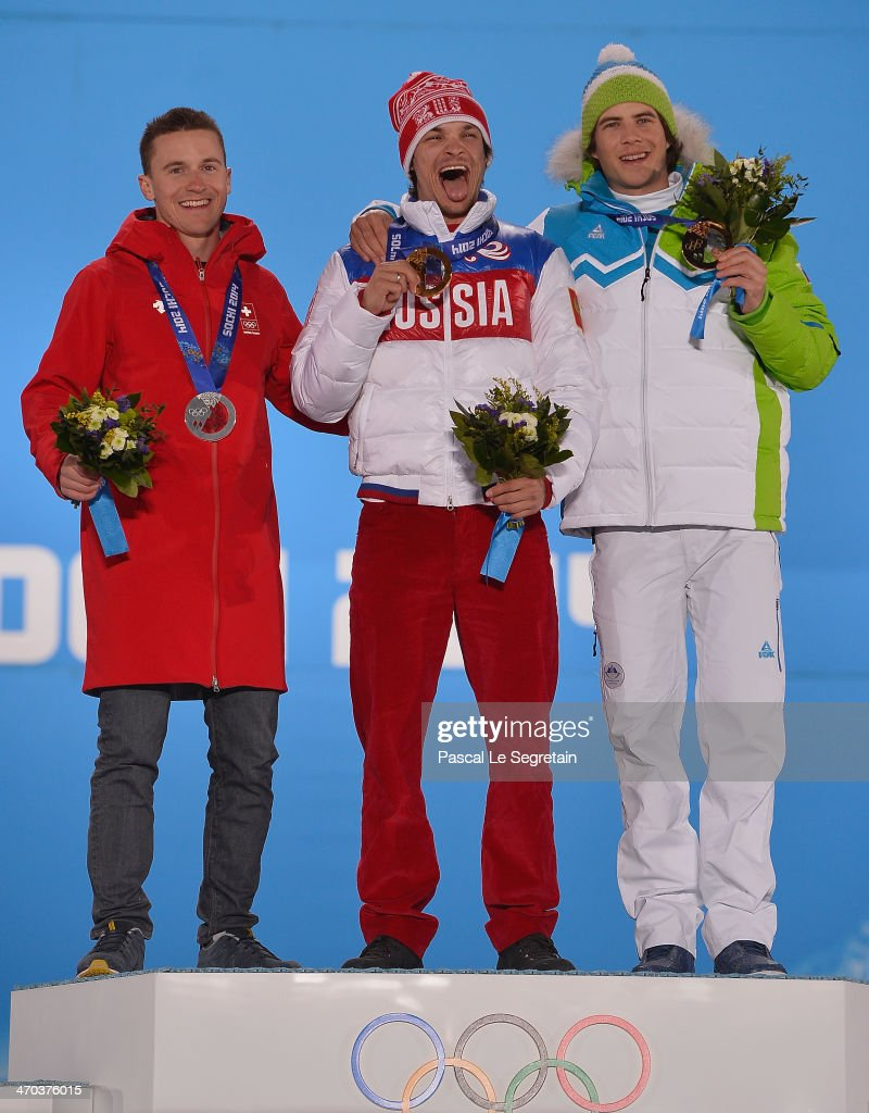 Silver medalist <a gi-track='captionPersonalityLinkClicked' href=/galleries/search?phrase=Nevin+Galmarini&family=editorial&specificpeople=10089437 ng-click='$event.stopPropagation()'>Nevin Galmarini</a> of Switzerland, gold medalist <a gi-track='captionPersonalityLinkClicked' href=/galleries/search?phrase=Vic+Wild&family=editorial&specificpeople=6691731 ng-click='$event.stopPropagation()'>Vic Wild</a> of Russia and bronze medalist Zan Kosir of Slovenia celebrate on the podium during the medal ceremony for the Men's Parallel Giant Slalom on day twelve of the Sochi 2014 Winter Olympics at at Medals Plaza on February 19, 2014 in Sochi, Russia.