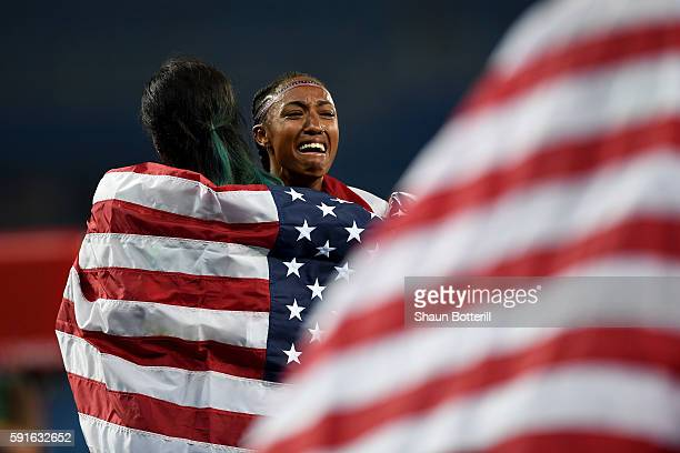 Silver medalist Nia Ali and gold medalist Brianna Rollins of the United States celebrate after the Women's 100m Hurdles Final on Day 12 of the Rio...