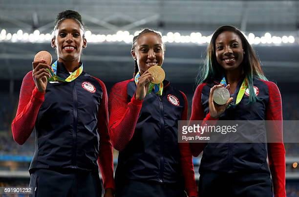 Silver medalist Nia Ali of the United States gold medalist Brianna Rollins of the United States and bronze medalist Kristi Castlin of the United...