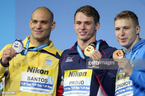 Silver medalist Nicholas Santos of Brazil gold medalist Benjamin Proud of Great Britain and bronze medalist Andrii Govorov of Ukraine pose with the...