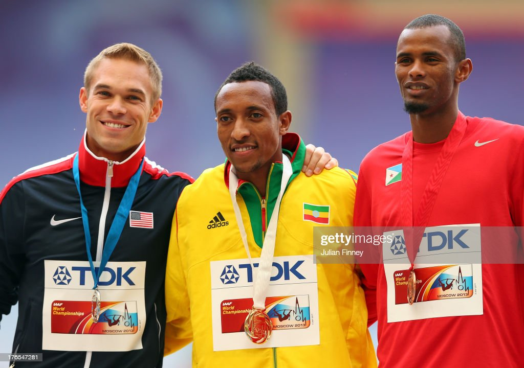 Silver medalist Nick Symmonds of the United States, gold medalist <a gi-track='captionPersonalityLinkClicked' href=/galleries/search?phrase=Mohammed+Aman&family=editorial&specificpeople=7149144 ng-click='$event.stopPropagation()'>Mohammed Aman</a> of Ethiopia and bronze medalist <a gi-track='captionPersonalityLinkClicked' href=/galleries/search?phrase=Ayanleh+Souleiman&family=editorial&specificpeople=9460907 ng-click='$event.stopPropagation()'>Ayanleh Souleiman</a> of Djibouti stand on the podium during the medal ceremony for the Men's 800 metres during Day Six of the 14th IAAF World Athletics Championships Moscow 2013 at Luzhniki Stadium on August 15, 2013 in Moscow, Russia.