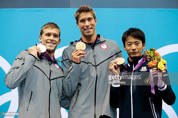 Silver medalist Nick Thoman of the United States gold medalist Matt Grevers of the United States and bronze medalist Ryosuke Irie of Japan celebrate...
