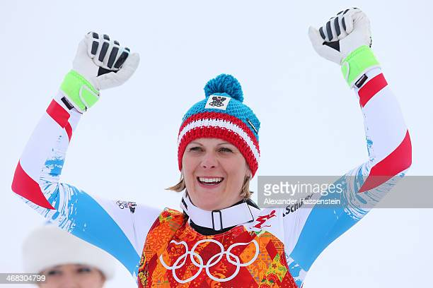 Silver medalist Nicole Hosp of Austria celebrates during the flower ceremony for the Alpine Skiing Women's Super Combined on day 3 of the Sochi 2014...