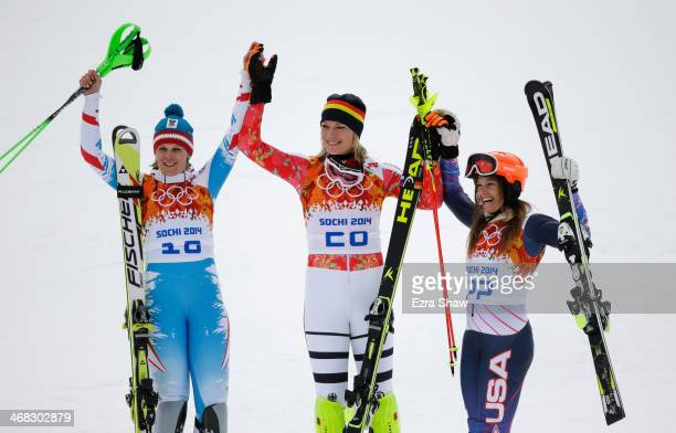 Silver medalist Nicole Hosp of Austria gold medalist Maria HoeflRiesch of Germany and bronze medalist Julia Mancuso of the United States celebrate...