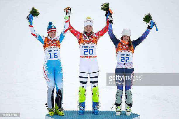 Silver medalist Nicole Hosp of Austria gold medalist Maria HoeflRiesch of Germany and bronze medalist Julia Mancuso of the United States on the...