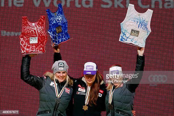 Silver medalist Nicole Hosp of Austria gold medalist Tina Maze of Slovenia and bronze medalist Michaela Kirchgasser of Austria stand on the podium...