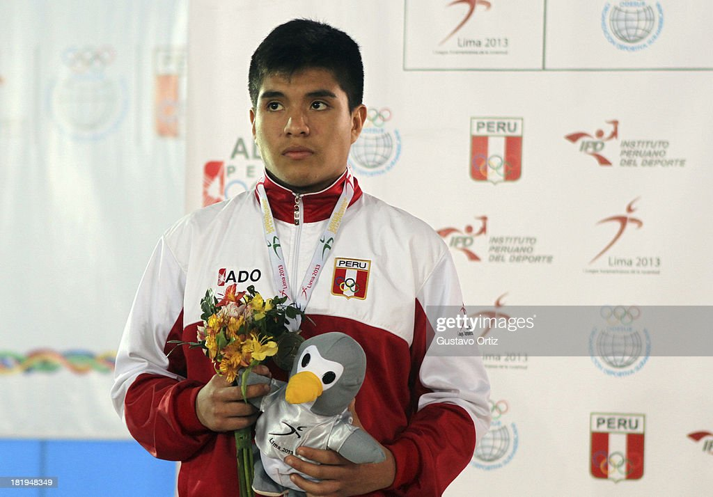 Silver medalist Nilton Soto of Peru in the podium of Greco Roman 69kg as part of the I ODESUR South American Youth Games at Polideportivo Villa Deportiva del Callao on September 26, 2013 in Lima, Peru.