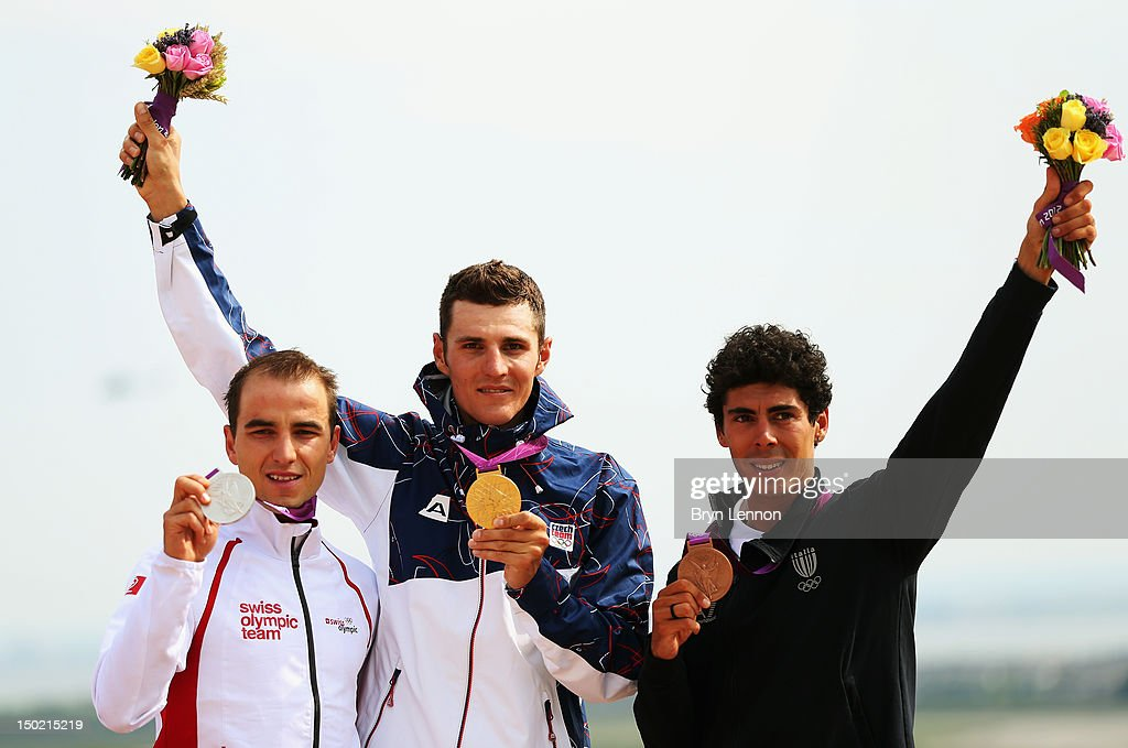 Silver medalist <a gi-track='captionPersonalityLinkClicked' href=/galleries/search?phrase=Nino+Schurter&family=editorial&specificpeople=2465930 ng-click='$event.stopPropagation()'>Nino Schurter</a> of Switzerland, Gold medalist <a gi-track='captionPersonalityLinkClicked' href=/galleries/search?phrase=Jaroslav+Kulhavy&family=editorial&specificpeople=4487819 ng-click='$event.stopPropagation()'>Jaroslav Kulhavy</a> of the Czech Republic and Bronze Medalist Marco Aurelio Fontana of Italy stand on the podium after the Men's Mountain Bike race on Day 16 of the 2012 Olympic Games at Hadleigh Farm on August 12, 2012 in Hadleigh, Essex.