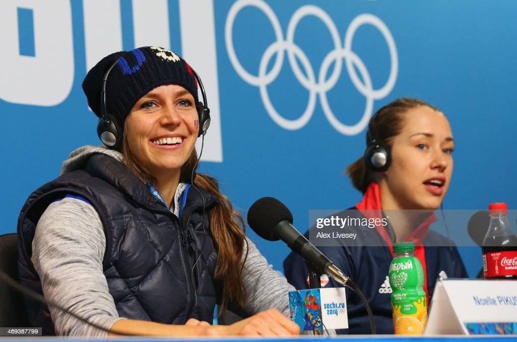 Silver medalist Noelle Pikus-Pace of the United States and gold medalist Lizzy Yarnold of Great Britain attend a press conference after the Women's Skeleton on Day 7 of the Sochi 2014 Winter Olympics at Sliding Center Sanki on February 14, 2014 in Sochi, Russia.