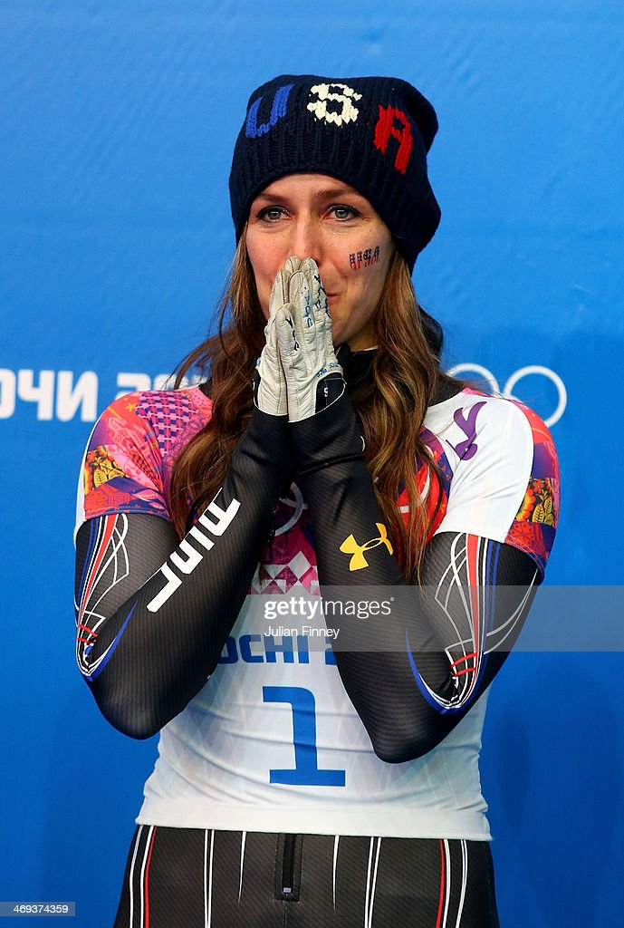 Silver medalist Noelle Pikus-Pace of the United States celebrates on the podium during the flower ceremony for the Women's Skelton on Day 7 of the Sochi 2014 Winter Olympics at Sliding Center Sanki on February 14, 2014 in Sochi, Russia.