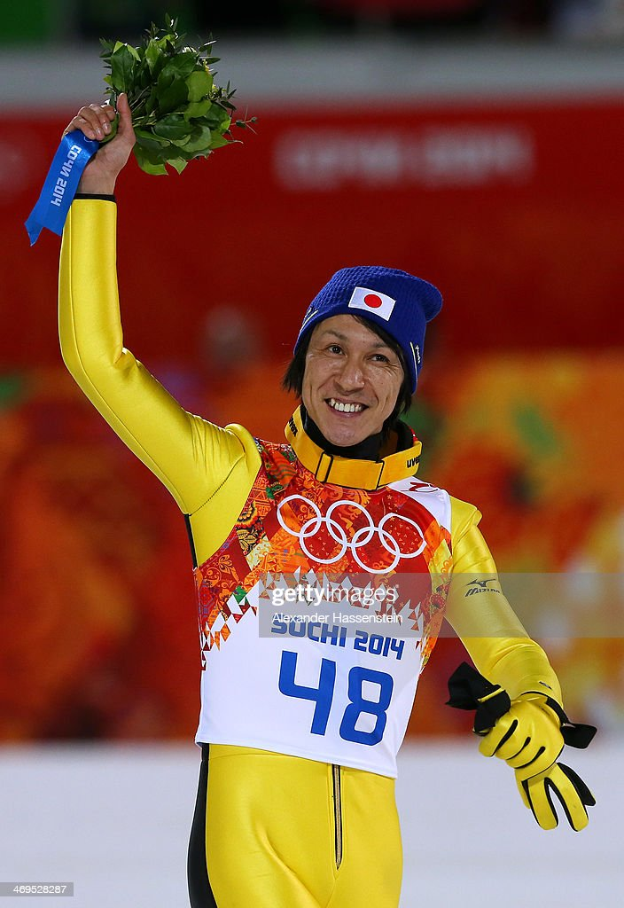 Silver medalist Noriaki Kasai of Japan celebrates after the flower ceremony after the Men's Large Hill Individual Final Round on day 8 of the Sochi 2014 Winter Olympics at the RusSki Gorki Ski Jumping Center on February 15, 2014 in Sochi, Russia.