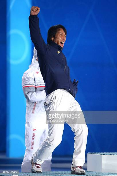Silver medalist Noriaki Kasai of Japan celebrates on the podium during the medal ceremony for the Men's Large Hill Individual on day 9 of the Sochi...