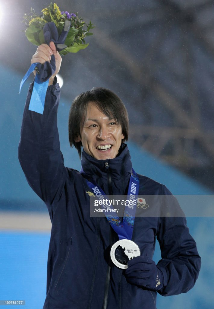 Silver medalist Noriaki Kasai of Japan celebrates on the podium during the medal ceremony for the Men's Large Hill Individual on day 9 of the Sochi 2014 Winter Olympics at Medals Plaza on February 16, 2014 in Sochi, Russia.