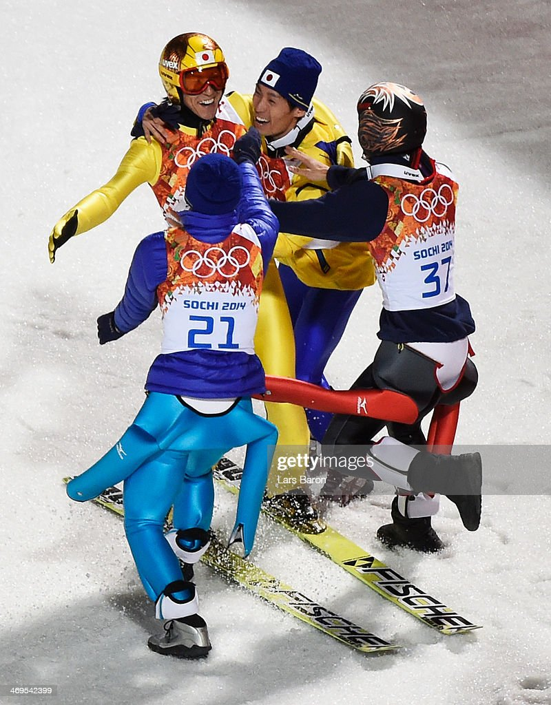 Silver medalist Noriaki Kasai of Japan (L) celebrates with Daiki Ito, Taku Takeuchi and Reruhi Shimizu of Japan after the Men's Large Hill Individual Final Round on day 8 of the Sochi 2014 Winter Olympics at the RusSki Gorki Ski Jumping Center on February 15, 2014 in Sochi, Russia.