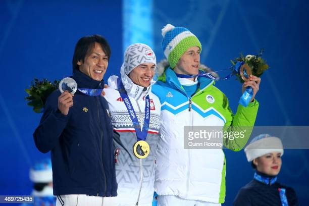 Silver medalist Noriaki Kasai of Japan gold medalist Kamil Stoch of Poland and bronze medalist Peter Prevc of Slovenia celebrate on the podium during...
