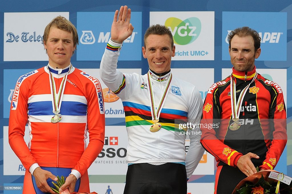 Silver medalist Norway's Edvald Boasson Hagen (L), Gold medalist Belgium's Philippe Gilbert (C) and Bronze medalist Spain's Antonio Valverde pose on the podium at the end of the Men's Elite Race at the UCI Road World Championships on September 23, 2012 in Valkenburg.
