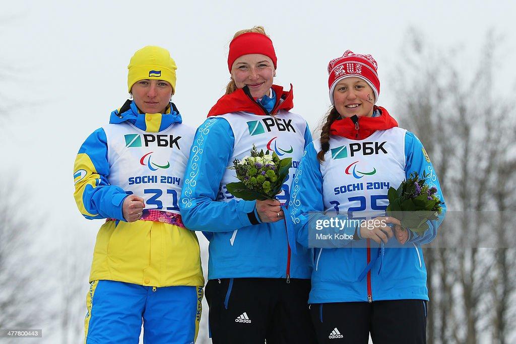 Silver medalist Oleksandra Kononova of Ukraine gold medalist Alena Kaufman of Russia and bronze medalist Natalia Bratiuk of Russia celebrate in the...