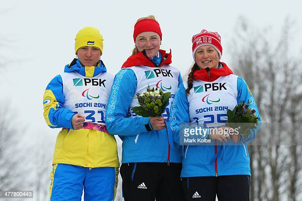 Silver medalist Oleksandra Kononova of Ukraine gold medalist Alena Kaufman of Russia and bronze medalist Natalia Bratiuk of Russia celebrate in the...