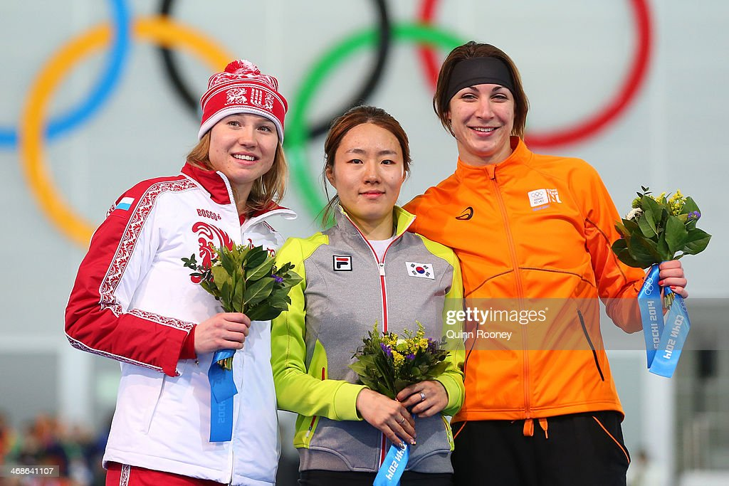 Silver medalist <a gi-track='captionPersonalityLinkClicked' href=/galleries/search?phrase=Olga+Fatkulina&family=editorial&specificpeople=6744260 ng-click='$event.stopPropagation()'>Olga Fatkulina</a> of Russia, gold medalist Sang Hwa Lee of South Korea and bronze medalist <a gi-track='captionPersonalityLinkClicked' href=/galleries/search?phrase=Margot+Boer&family=editorial&specificpeople=4691692 ng-click='$event.stopPropagation()'>Margot Boer</a> of the Netherlands on the podium during the flower ceremony for the Speed Skating Women's 500m Event during day 4 of the Sochi 2014 Winter Olympics at Adler Arena Skating Center on February 11, 2014 in Sochi, Russia.