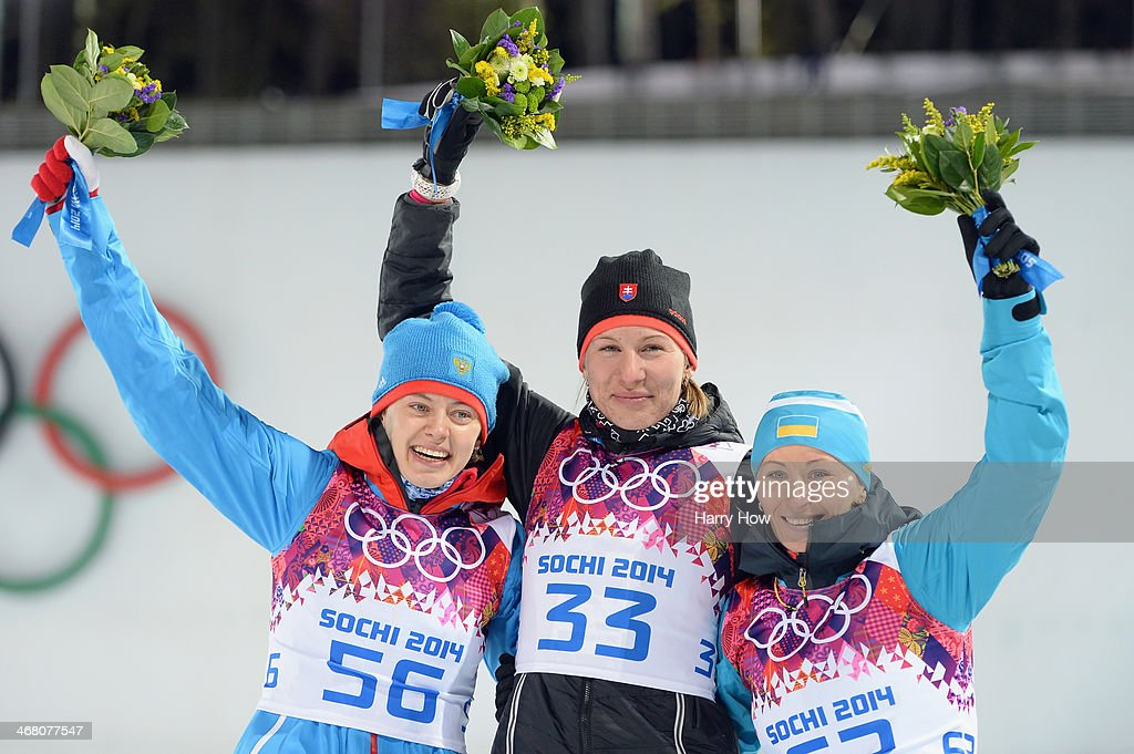 Silver medalist <a gi-track='captionPersonalityLinkClicked' href=/galleries/search?phrase=Olga+Vilukhina&family=editorial&specificpeople=7398357 ng-click='$event.stopPropagation()'>Olga Vilukhina</a> of Russia, gold medalist <a gi-track='captionPersonalityLinkClicked' href=/galleries/search?phrase=Anastasiya+Kuzmina&family=editorial&specificpeople=6738529 ng-click='$event.stopPropagation()'>Anastasiya Kuzmina</a> of Slovakia and bronze medalist <a gi-track='captionPersonalityLinkClicked' href=/galleries/search?phrase=Vita+Semerenko&family=editorial&specificpeople=4894891 ng-click='$event.stopPropagation()'>Vita Semerenko</a> of Ukraine pose during the flower ceremony after the Women's 7.5 km Sprint during day two of the Sochi 2014 Winter Olympics at Laura Cross-country Ski & Biathlon Center on February 9, 2014 in Sochi, Russia.