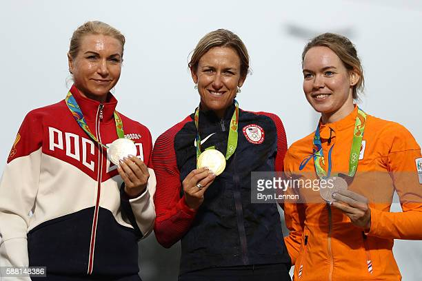 Silver medalist Olga Zabelinskaya of Russia gold medalist Kristin Armstrong of the United States and bronze medalist Anna van der Breggen of the...