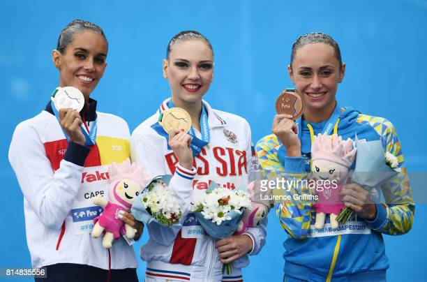 Silver medalist Ona Carbonell of Spain gold medalist Svetlana Kolesnichenko of Russia and bronze medalist Anna Voloshyna of Ukraine pose with the...