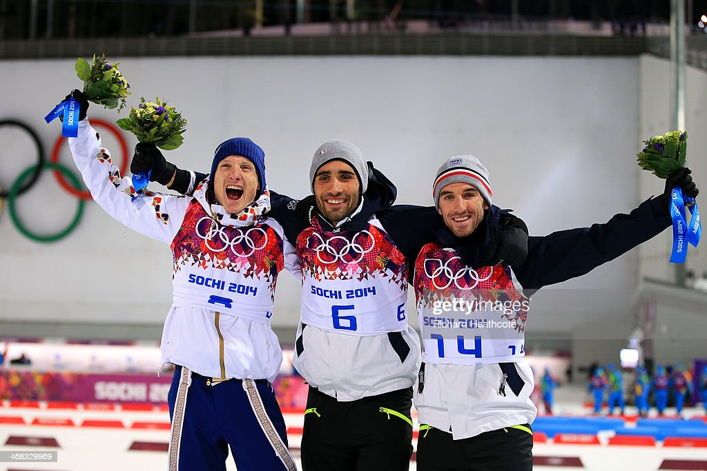 Silver medalist Ondrej Moravec of Czech Republic, gold medalist <a gi-track='captionPersonalityLinkClicked' href=/galleries/search?phrase=Martin+Fourcade&family=editorial&specificpeople=5656850 ng-click='$event.stopPropagation()'>Martin Fourcade</a> of France and bronze medalist Jean Guillaume Beatrix of France celebrate on the podium during the flower ceremony for the Men's 12.5 km Pursuit during day three of the Sochi 2014 Winter Olympics at Laura Cross-country Ski & Biathlon Center on February 10, 2014 in Sochi, Russia.