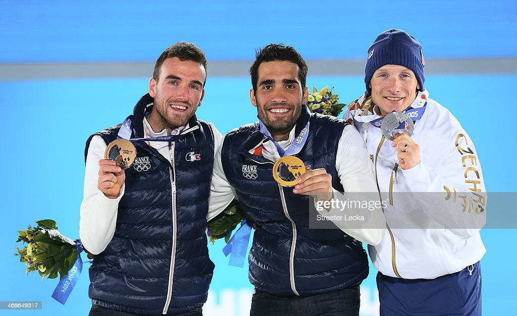 Silver medalist Ondrej Moravec of the Czech Republic (R) , gold medalist <a gi-track='captionPersonalityLinkClicked' href=/galleries/search?phrase=Martin+Fourcade&family=editorial&specificpeople=5656850 ng-click='$event.stopPropagation()'>Martin Fourcade</a> of France and bronze medalist Jean Guillaume Beatrix (L) of France celebrate on the podium during the medal ceremony for the for the Men's 12.5 km Pursuit on day 4 of the Sochi 2014 Winter Olympics at Medals Plaza on February 11, 2014 in Sochi, Russia.