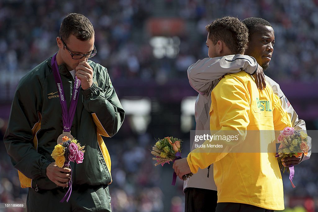 Silver medalist Oscar Pistorius from South Africa , gold medalist Alan Fonteles Cardoso Oliveira from Brazil and bronze medalist Blake Leeper from the United States pose for a picture during the award ceremony at the Olympic Stadium on September 03, 2012 in London, England.