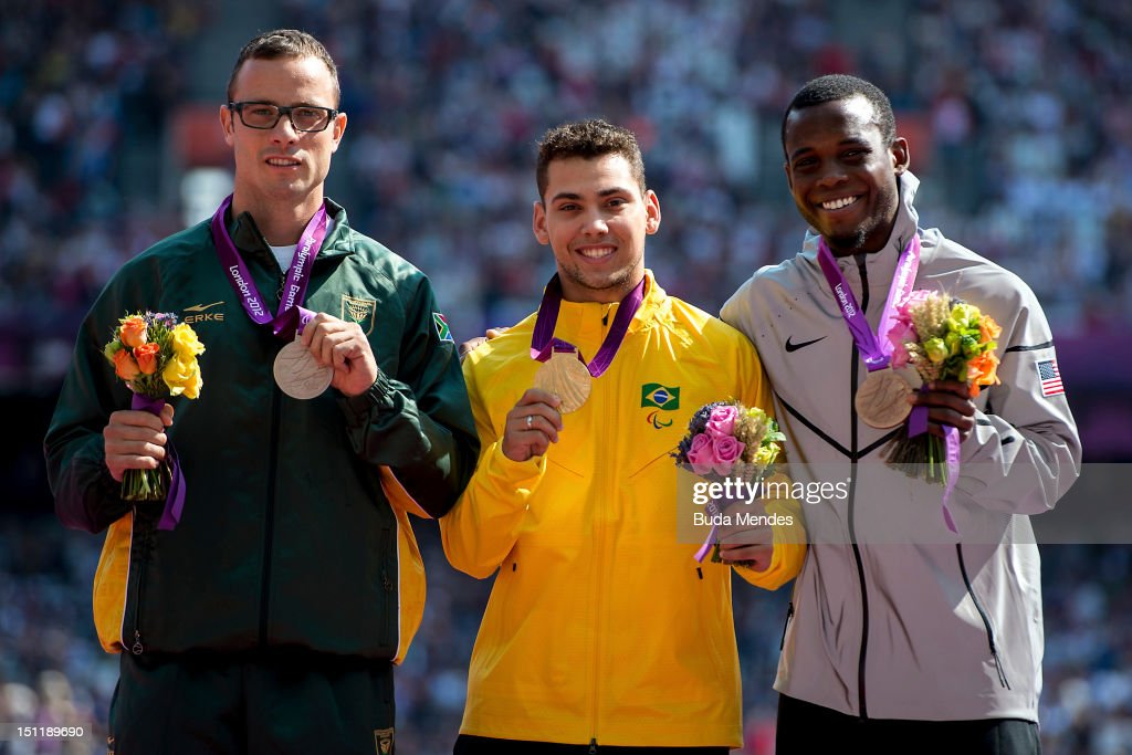 Silver medalist <a gi-track='captionPersonalityLinkClicked' href=/galleries/search?phrase=Oscar+Pistorius&family=editorial&specificpeople=224406 ng-click='$event.stopPropagation()'>Oscar Pistorius</a> from South Africa , gold medalist <a gi-track='captionPersonalityLinkClicked' href=/galleries/search?phrase=Alan+Fonteles+Cardoso+Oliveira&family=editorial&specificpeople=9688610 ng-click='$event.stopPropagation()'>Alan Fonteles Cardoso Oliveira</a> from Brazil and bronze medalist Blake Leeper from the United States pose for a picture during the award ceremony at the Olympic Stadium on September 03, 2012 in London, England.