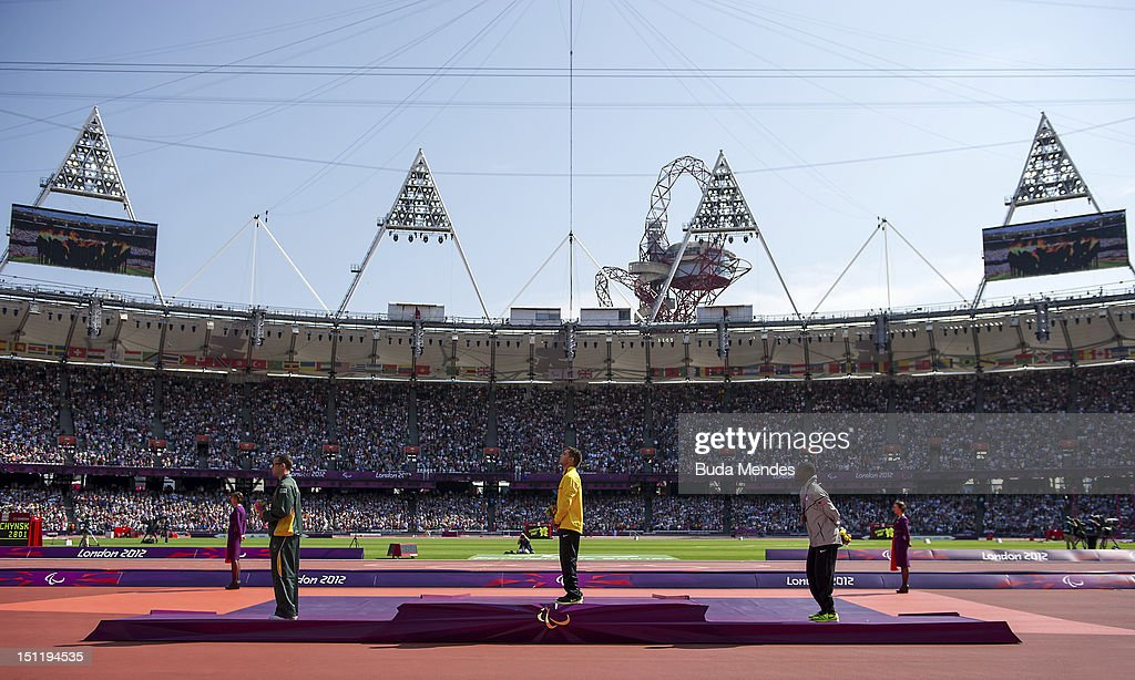 Silver medalist Oscar Pistorius, from South Africa, the gold medalist Alan Fonteles Cardoso Oliveira from Brazil, and bronze medalist Blake Leeper, from the United States at London 2012 Paralympic Games at the Olympic Stadium on September 03, 2012 in London, England.