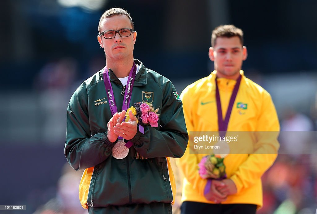 Silver medalist <a gi-track='captionPersonalityLinkClicked' href=/galleries/search?phrase=Oscar+Pistorius&family=editorial&specificpeople=224406 ng-click='$event.stopPropagation()'>Oscar Pistorius</a> of South Africa and gold medalist <a gi-track='captionPersonalityLinkClicked' href=/galleries/search?phrase=Alan+Fonteles+Cardoso+Oliveira&family=editorial&specificpeople=9688610 ng-click='$event.stopPropagation()'>Alan Fonteles Cardoso Oliveira</a> pose on the podium during the medal ceremony for the Men's 200m - T44 on day 5 of the London 2012 Paralympic Games at Olympic Stadium on September 3, 2012 in London, England.